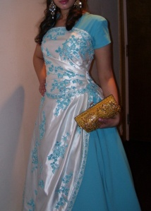 photo of blue and turquoise ball gown